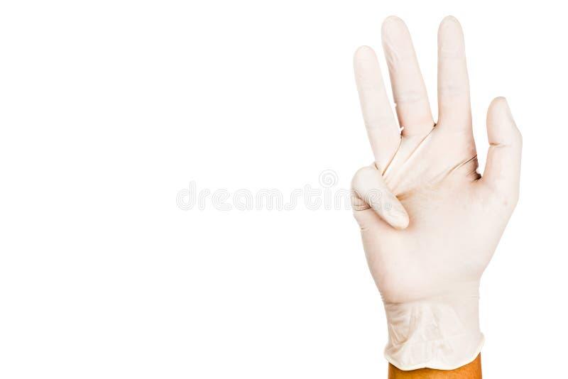 Hand i den kirurgiska latexhandskegesten nummer nio arkivfoton