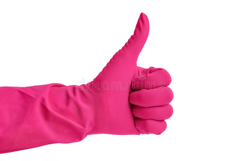 Hand i den rosa gummihandsken för att göra ren som isoleras över vit backg arkivfoto