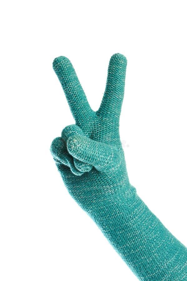 Hand i isolerade stack gröna handskar Victory Gesture arkivbilder