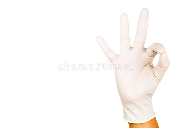 Hand i kirurgiskt godkännande för latexhandskegest mot den vita backgrouen royaltyfria foton