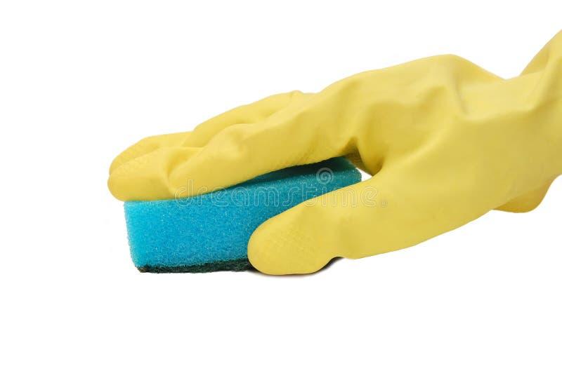 Hand im gelben Handschuh mit Schwamm stockfotos