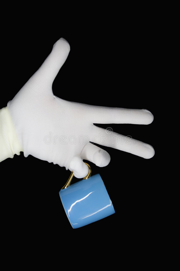 Free Hand In A White Glove With A Blue Cup Stock Photos - 7849193