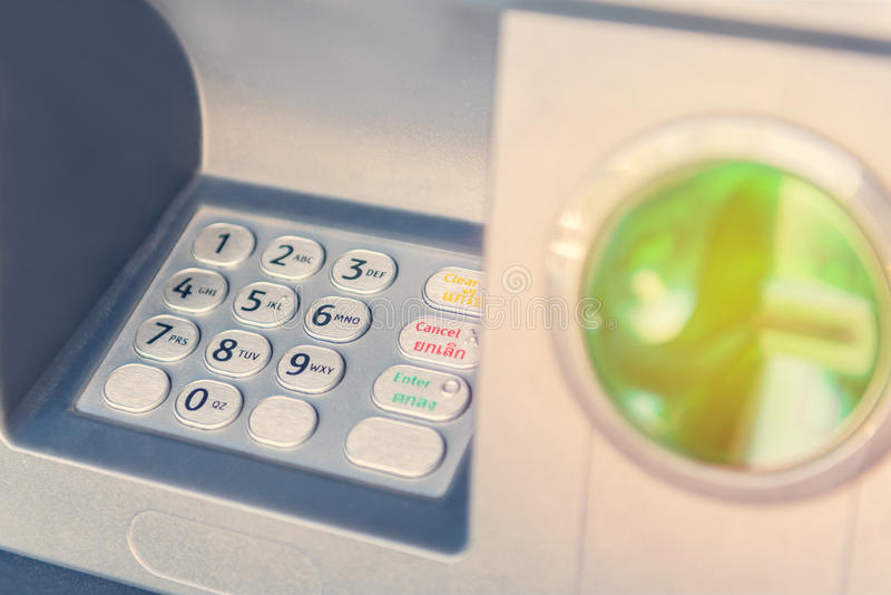 Hand insert credit card to ATM bank cash machine for withdraw mo royalty free stock photography