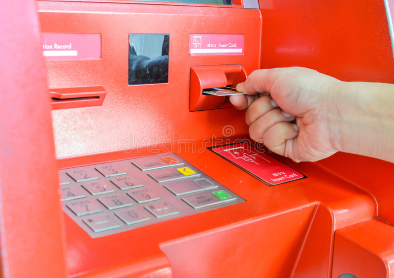 Hand inserting ATM card. In ATM machine royalty free stock photography