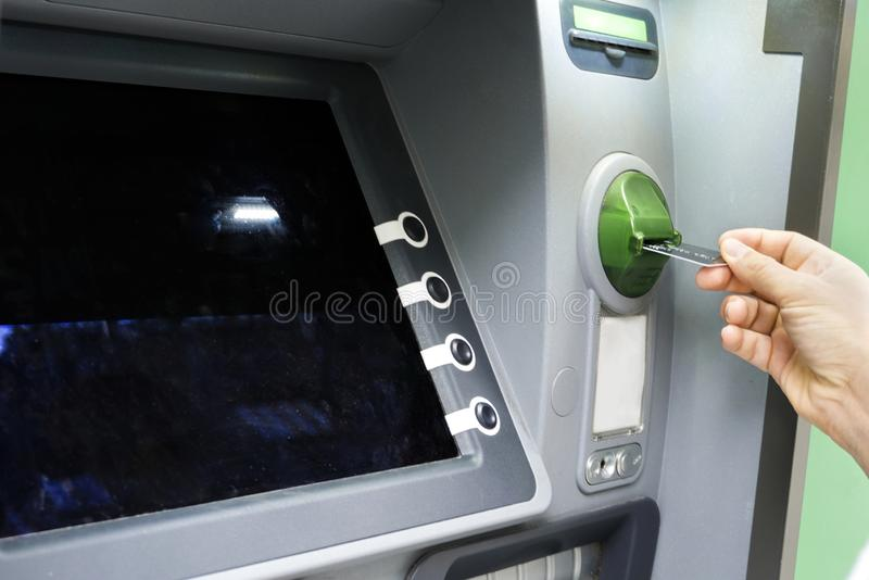 Hand inserting ATM credit card stock image