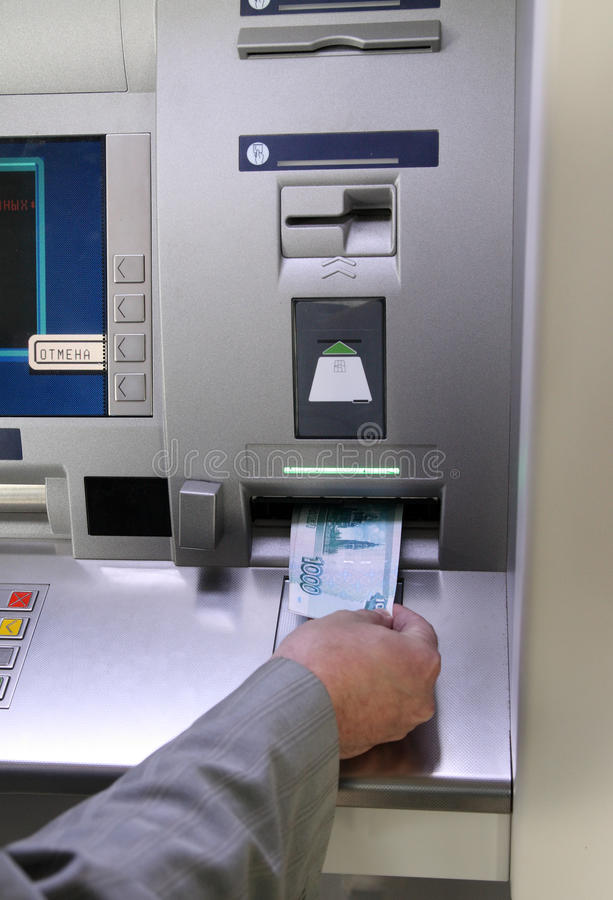 Hand Inserting Banknote Into Cash Dispense Stock Images