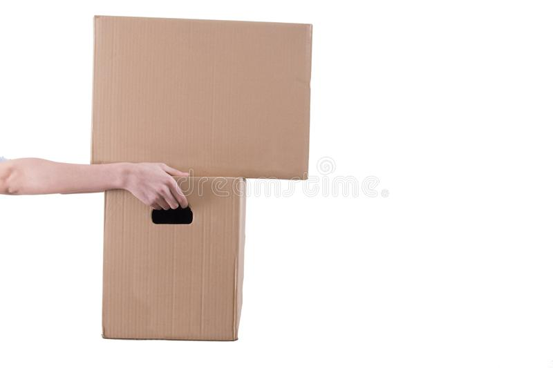 Hand with insulated boxes in white. Background stock image