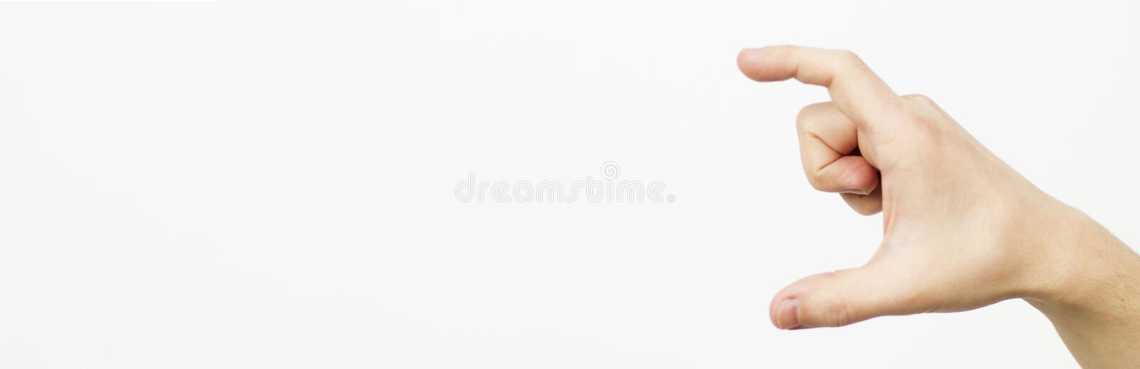 Hand isolated at white background making size measuring gesture - human hand measuring invisible items. Isolated on white. Copy. Space. Banner of billboard stock photo