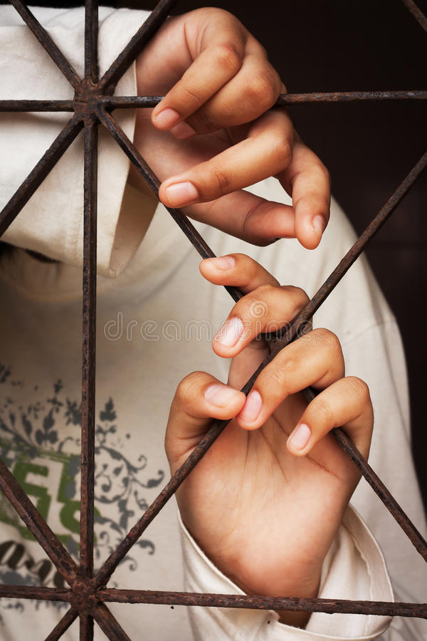 Hand in jail bars. Hand girl in jail bars royalty free stock photos