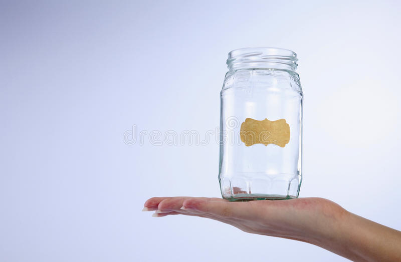 Hand with jar stock photography