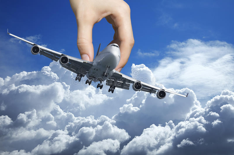 Hand with a jet plane. Hand playing with a real jet aircraft royalty free stock images