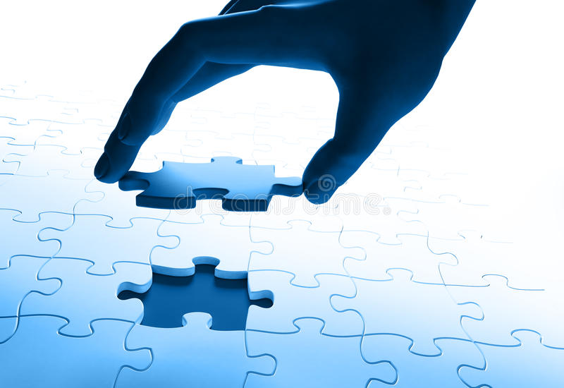 Download Hand Joining A  Puzzle Royalty Free Stock Photo - Image: 17379995