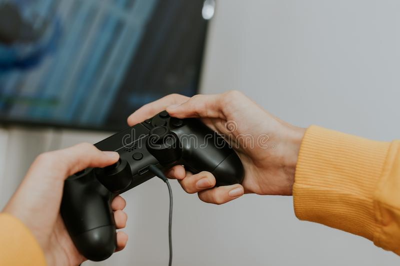 Hand with the joystick playing. Video games stock photography