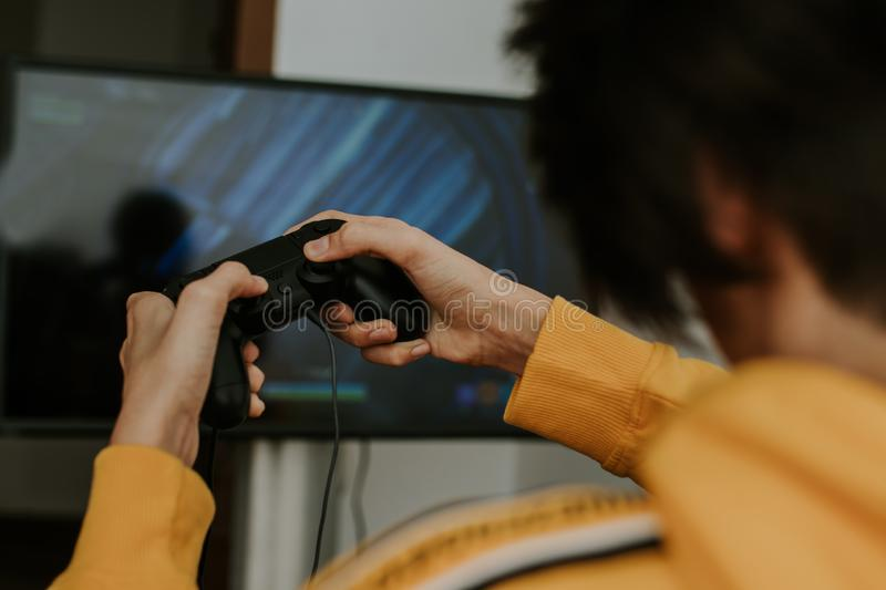 Hand with the joystick playing. Video games royalty free stock photos