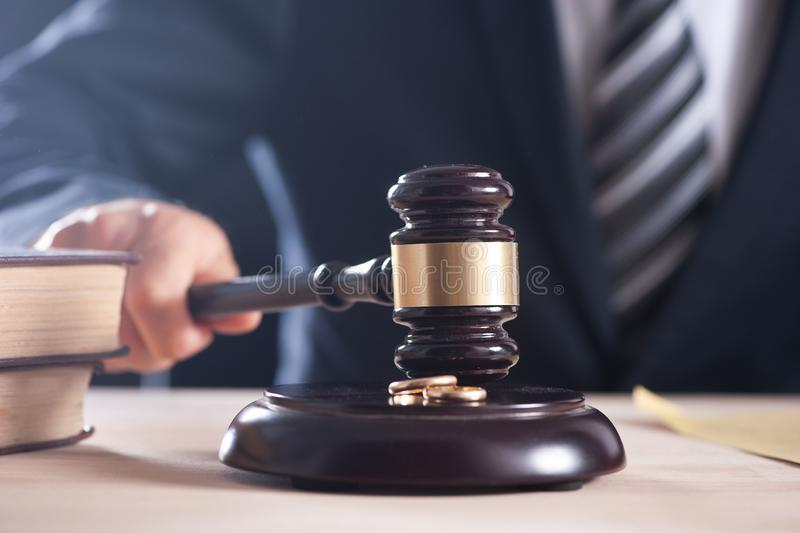 Hand of a judge holding a hammer or gavel stock image