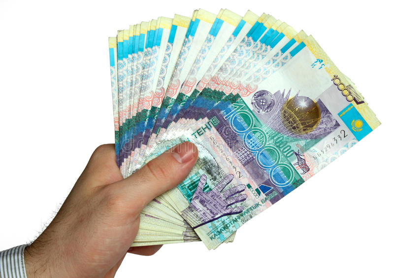 Hand with kazakh money royalty free stock image