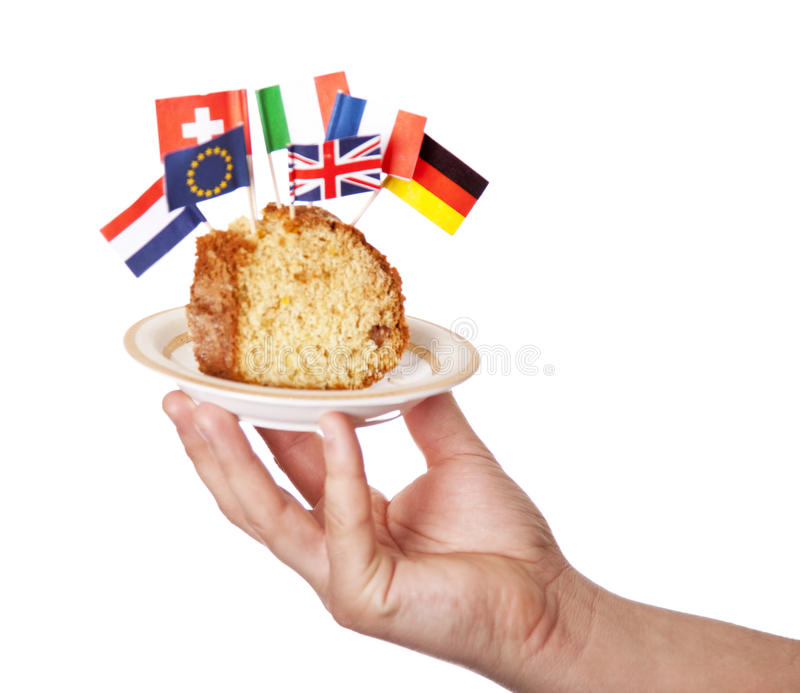 Hand Keep Cake With Some European Flags. Royalty Free Stock Image