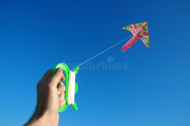 Hand Keeps Kite Stock Images
