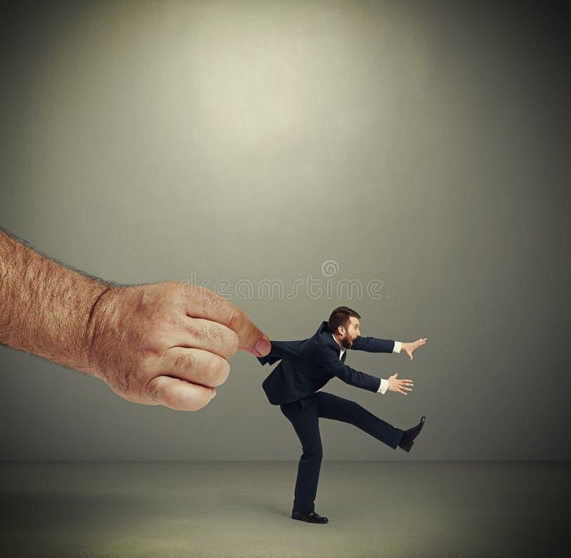 Hand kepping emotional running businessman royalty free stock photo
