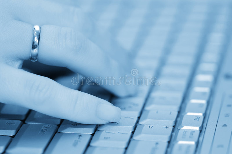 Hand on keyboard. Selective focus hand on keyboard royalty free stock photography