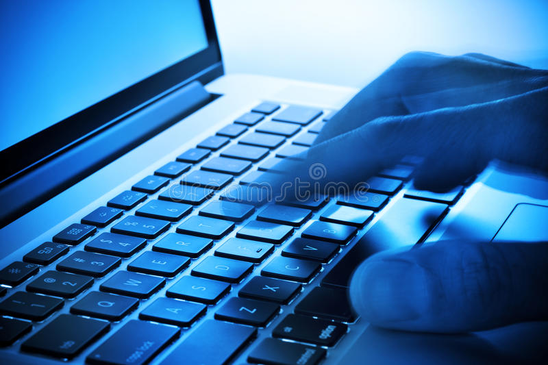 Hand Keyboard Computer Business. A mans fingers pushing keys on a laptop computer keyboard with movement