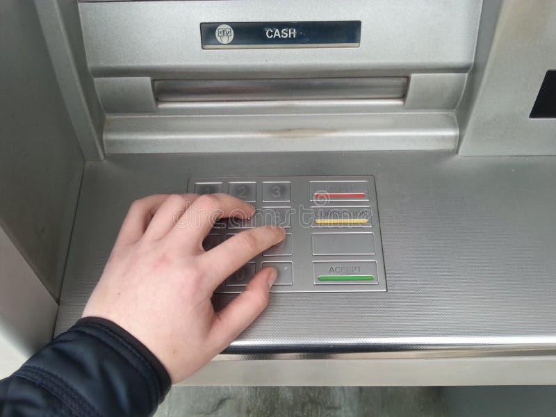 hand the keys ATM royalty free stock photos