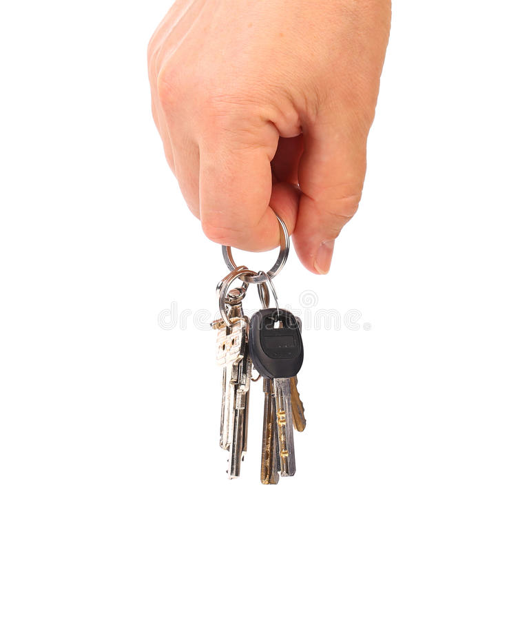 Hand with keys. Hand with several keys. Isolated on white background stock image