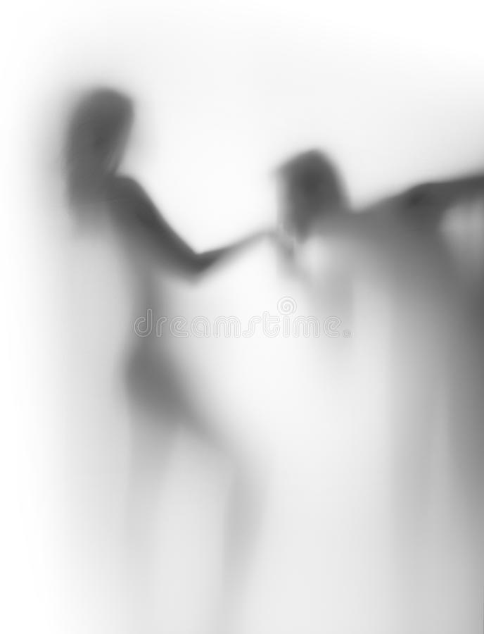 Hand kiss, lover couple silhouette. Human female and male body shape together behind a curtain royalty free stock photography