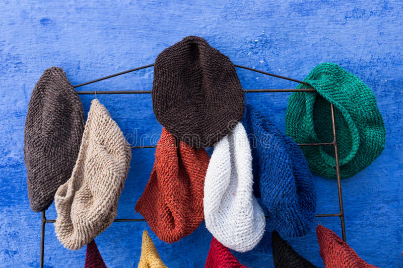 Hand knit hats stock images