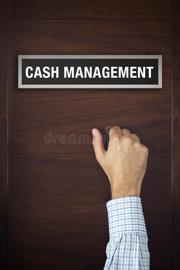 Hand is knocking on Cash Management door. Male hand is knocking on Cash Management wooden door, conceptual image. Visitor or guest is at the door royalty free stock image