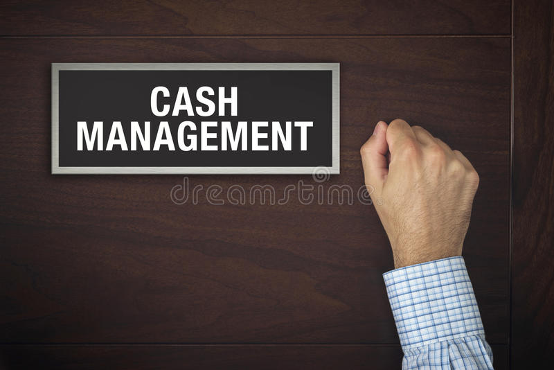 Hand is knocking on Cash Management door. Male hand is knocking on Cash Management wooden door, conceptual image. Visitor or guest is at the door stock image