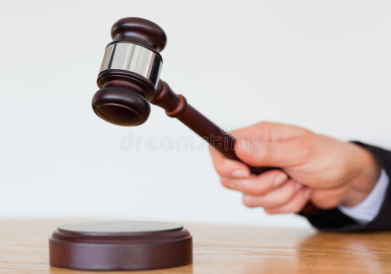Hand knocking a gavel stock photos