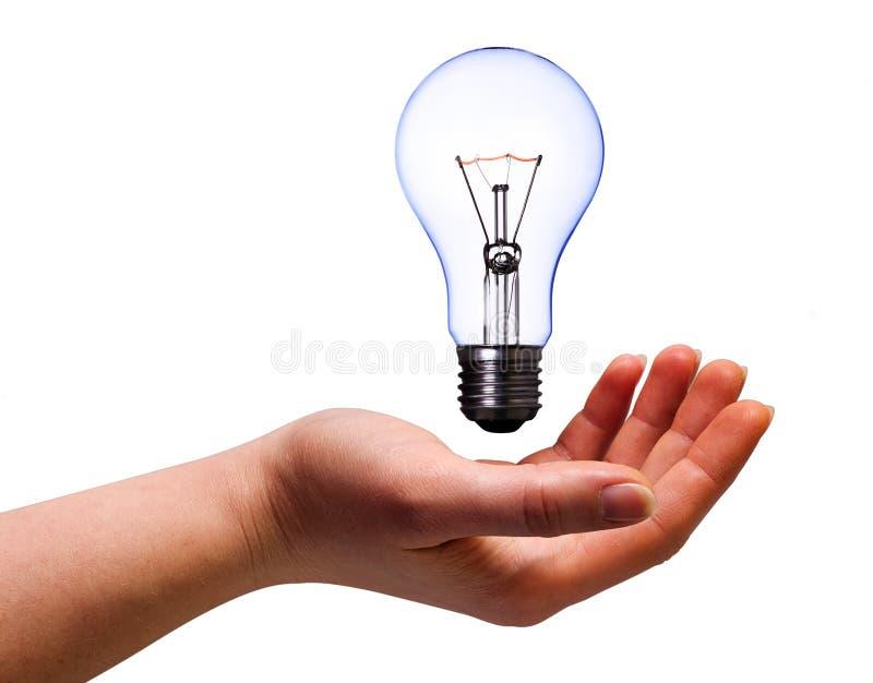 Hand with lamp bulb stock photos