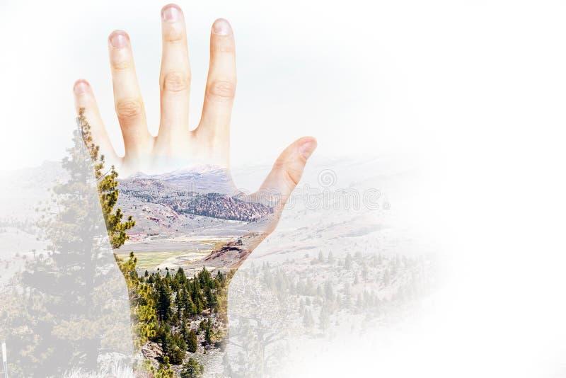 Hand on landscape background stock images