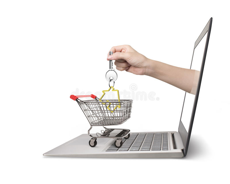 Hand from laptop screen taking house key in shopping cart. Female hand from laptop screen taking house key in the shopping cart, isolated on white background royalty free stock images