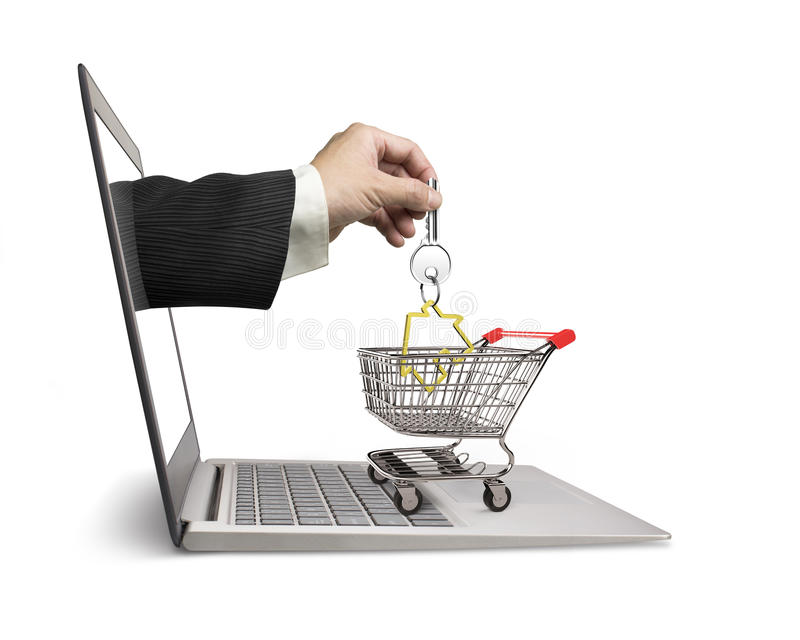 Hand from laptop screen taking house key in shopping cart. Male hand from laptop screen taking house key in the shopping cart, isolated on white background, real stock images
