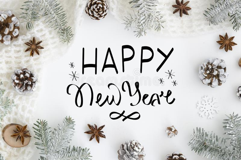 Hand lettering greeting card Happy new year on white Background. Christmas Greeting Card. Christmas Decoration Tree. Cones, anise, rope, snow. Trendy letters stock photography
