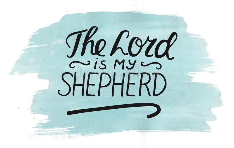 Hand lettering The Lord is my shepherd with stick on watercolor background. Hand lettering The Lord is my shepherd with stick. Biblical background. Christian stock photo