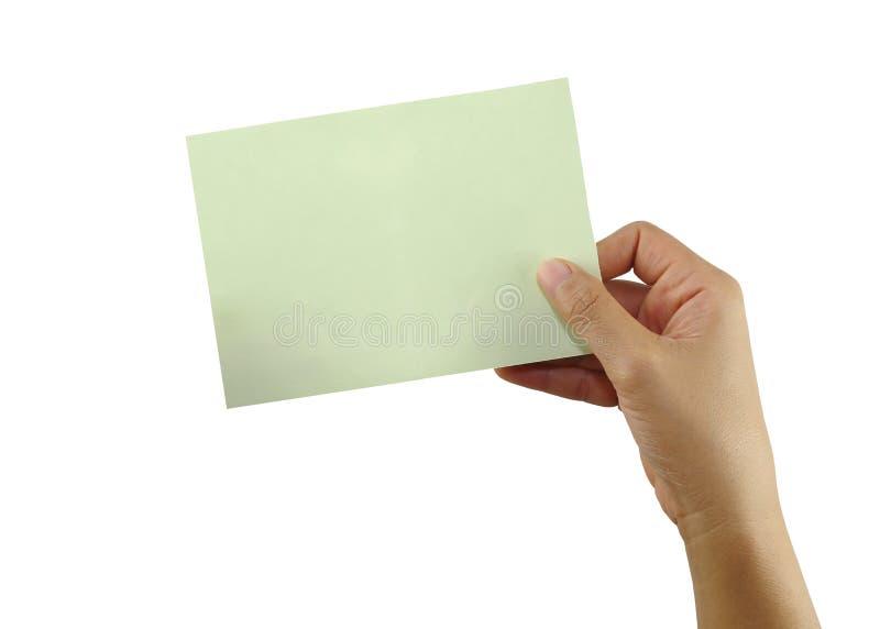 Hand Leute, die eine leere Grünbuchanmerkung lokalisiert auf wh halten stockfotografie