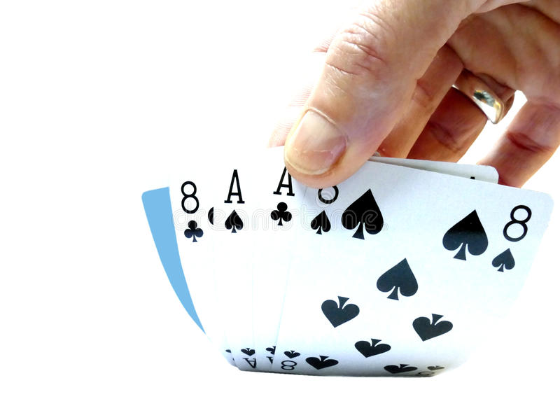 Hand lifting up a Dead man's hand, two-pair poker hand consistin. G of the black aces and black eights stock photography