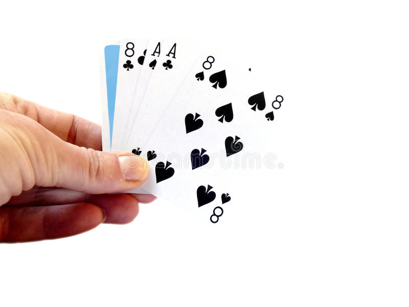 Hand lifting up a Dead man's hand, two-pair poker hand consistin. G of the black aces and black eights royalty free stock photo