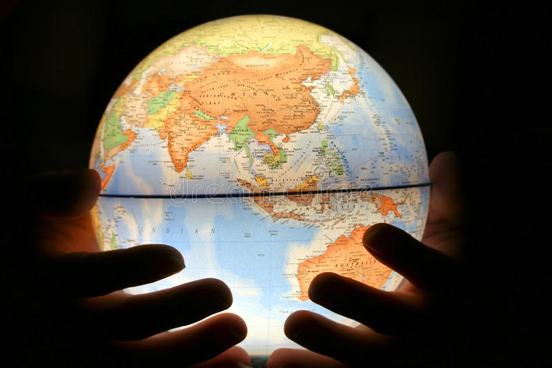 Hand on light globe stock photography