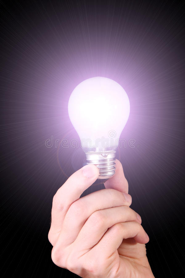 Hand with lightbulb stock photo