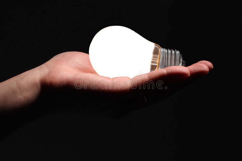Hand with lightbulb royalty free stock photo