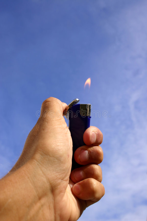 Download Hand, Lighter and Sky stock image. Image of tobacco, zippo - 181897