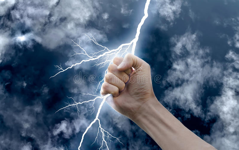Hand with a lightning stock photo