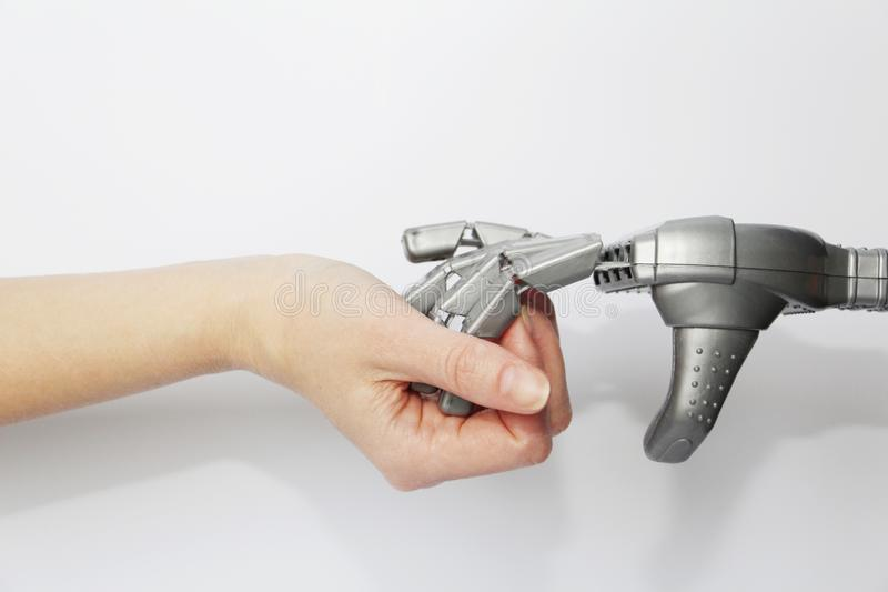 The hand of a living person and the hand of a robot together stock images