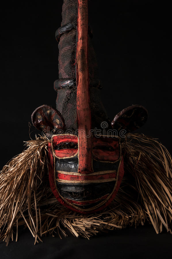 Hand made African mask with ropes simulating hair. Human face. I. Solated on black background. Isolated royalty free stock images