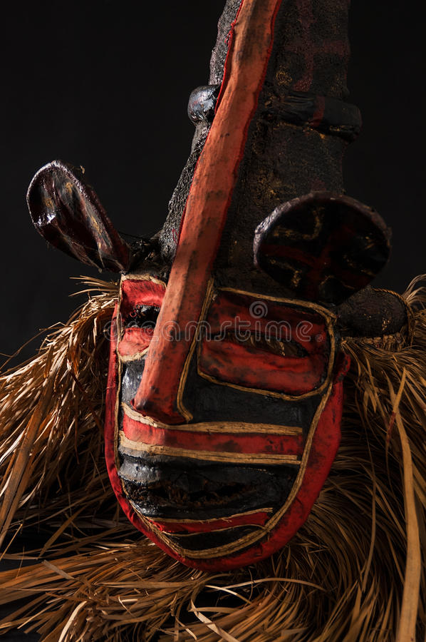 Hand made African mask with ropes simulating hair. Human face. I. Solated on black background. Isolated stock photos