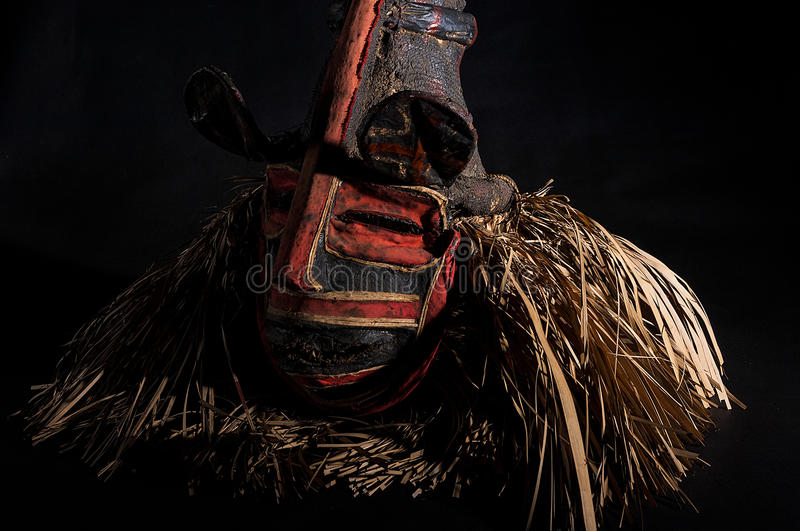 Hand made African mask with ropes simulating hair. Human face. I. Solated on black background. Isolated royalty free stock photos